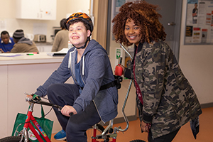 Client on bike with support worker