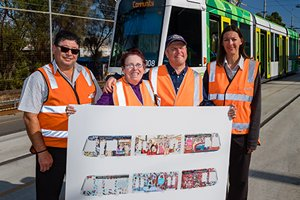 Two Yarra Trams staff, Able client Cathy Staughton and another artist standing in front of a Yarra Trams tram.