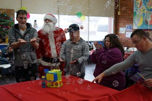 Able clients at the Young Adult Program day centre at their Christmas in July event.