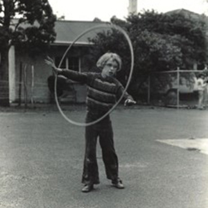 Black and White image of boy with a hula hoop