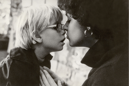 Black and White photo child and adult woman touching noses