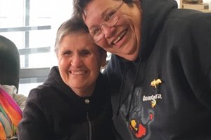 Able client Deb smiling with Aboriginal Elder Judith Jackson at Able's NAIDOC week celebration