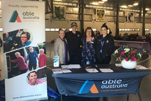 Two Able Australia staff and two Queensland Police Officers at the World Elder Abuse Awareness Day Able Australia display