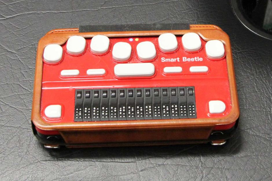 Red and White Smart Beetle Braille Machine